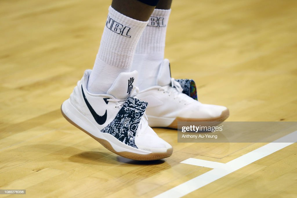 new concept 78b31 b5cc4 Cedric Jackson of the Hawks wears the Nike Kyrie 4 Low ...
