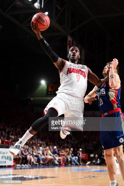 Cedric Jackson of the Illawarra Hawks makes a basket past Nathan Sobey of the Adelaide 36ers during the round six NBL match between the Adelaide...