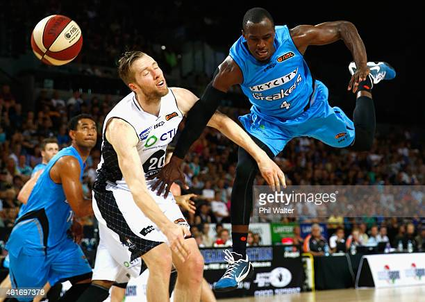 Cedric Jackson of the NZ Breakers looses the ball under pressure from David Barlow of Melbourne United during the round 15 NBL match between the New...