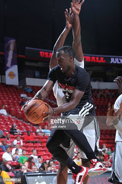 Cedric Jackson of the Portland Trailblazers passes the ball in mid-air against the Minnesota Timberwolves during NBA Summer League on July 19, 2013...