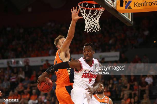 Cedric Jackson passes during the round eight NBL match between the Cairns Taipans and the Illawarra Hawks at Cairns Convention Centre on December 7,...