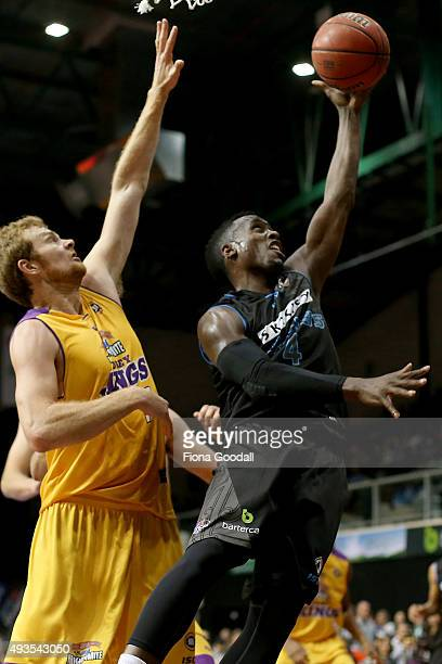 Cedric Jackson shoots for the Breakers with Tommy Garleep in defence for the Kings during the round three NBL match between the New Zealand Breakers...