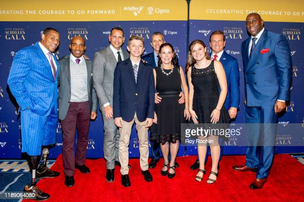 Cedric King, Tiki Barber, Alex Rodriguez, David Cordani with his children, Joe Theismann and Magic Johnson attend the 29th Annual Achilles Gala at...