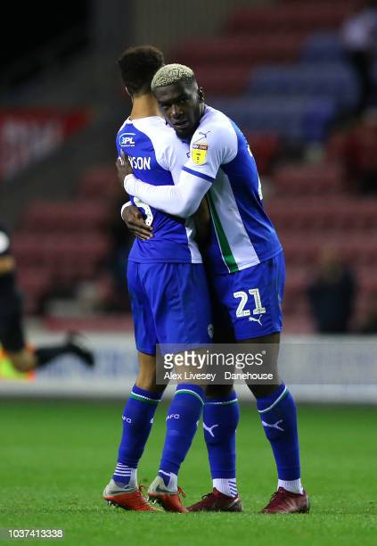Cedric Kipre and Antonee Robinson of Wigan Athletic celebrate after victory over Bristol City during the Sky Bet Championship match between Wigan...