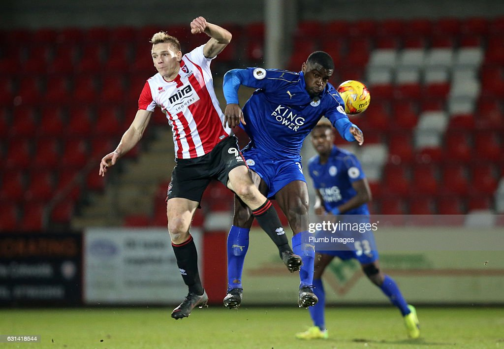 Cedric Kipre of Leicester City in action with Danny Wright of Cheltenham Town during the EFL Checkatrade Trophy Second Round tie between Cheltenham Town and Leicester City at Whaddon Road Stadium on January 10, 2017 in Cheltenham, England.