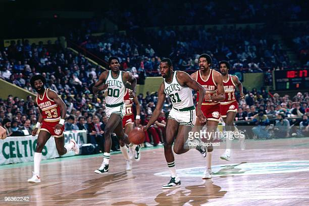 Cedric Maxwell of the Boston Celtics drives the ball up court on a fast break against the Cleveland Cavaliers during a game played in 1981 at the...