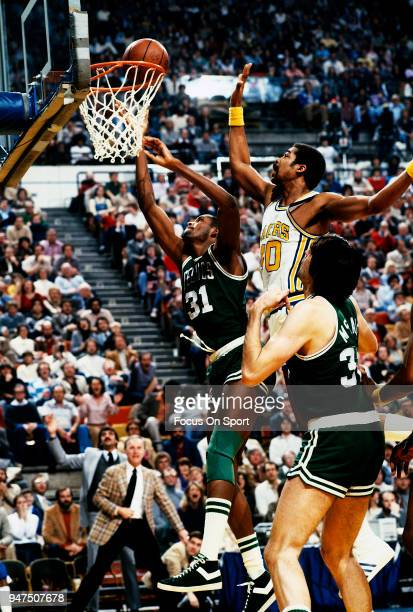 Cedric Maxwell of the Boston Celtics goes in for a layup over James Edwards of the Indiana Pacers during an NBA basketball game circa 1980 at Market...