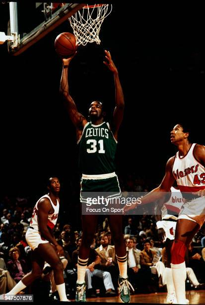 Cedric Maxwell of the Boston Celtics goes in for a layup over Mychal Thompson of the Portland Trail Blazers during an NBA basketball game circa 1980...
