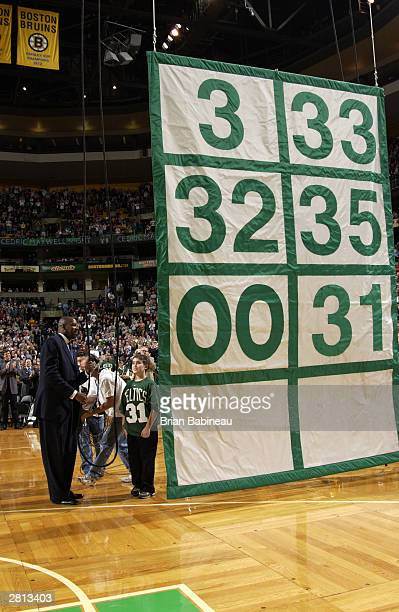 Cedric Maxwell of the Boston Celtics has his number retired during the game against the Minnesota Timberwolves at the Fleetcenter December 15 2003 in...