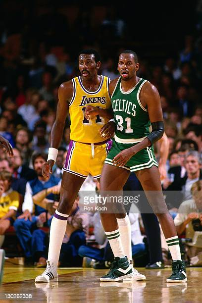 Cedric Maxwell of the Boston Celtics posts up against Bob McAdoo of the Los Angeles Lakers during a game played circa 1985 at the Great Western Forum...