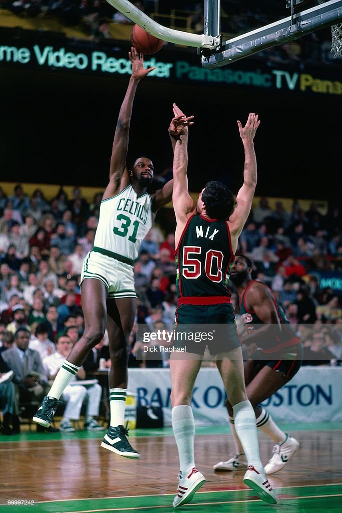 Cedric Maxwell #31 of the Boston Celtics shoots a layup against Steve Mix #50 of the Milwaukee Bucks during a game played in 1983 at the Boston Garden in Boston, Massachusetts.