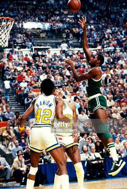 Cedric Maxwell of the Boston Celtics shoots over Clemon Johnson of the Indiana Pacers during an NBA basketball game circa 1980 at Market Square Arena...