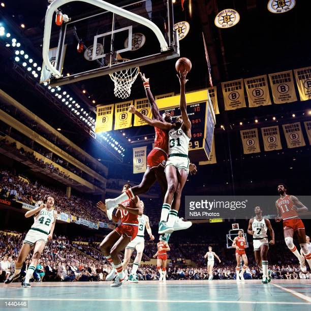 Cedric Maxwell#31 of the Boston Celtics drives to the basket for a layup against the Philadelphia 76ers during the NBA game at The Boston Garden in...