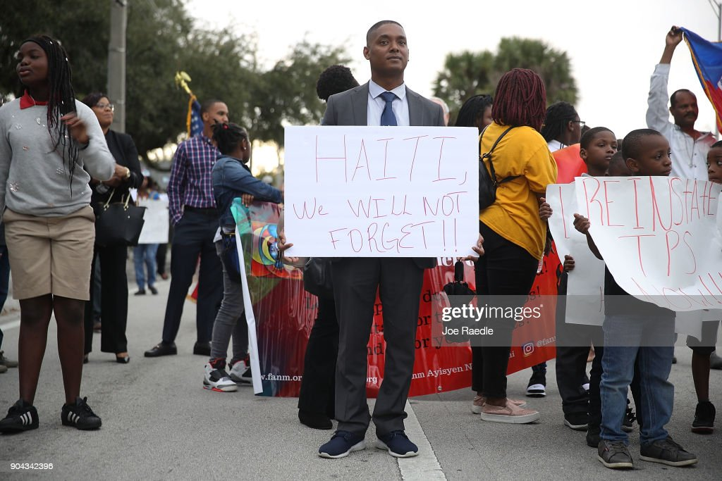 Cedric McMinn joins with others to mark the 8th anniversary of the massive earthquake in Haiti and to condemn President Donald Trump's reported statement about immigrants from Haiti, Africa and El Salvador on January 12, 2018 in Miami, Florida. President Trump is reported to have called those places 'shithole countries' whose inhabitants are not desirable for U.S. immigration.