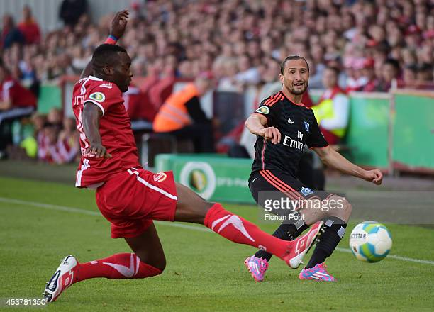 Cedric Mimbala of FC Energie Cottbus vies with Petr Jiracek of Hamburger SV during the DFP Cup first round match between Energie Cottbus and...
