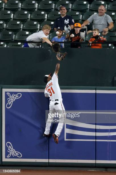 Cedric Mullins of the Baltimore Orioles catches a ball hit by Gary Sanchez of the New York Yankees for the third out of the second inning at Oriole...