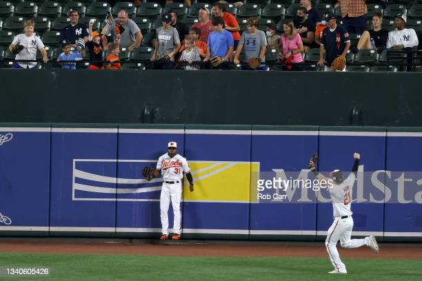 Cedric Mullins of the Baltimore Orioles celebrates with Austin Hays catching a ball hit by Gary Sanchez of the New York Yankees for the third out of...