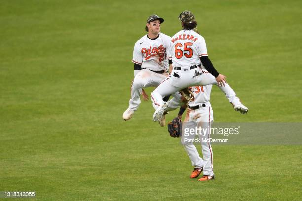 Cedric Mullins of the Baltimore Orioles celebrates with his teammates Austin Hays and Ryan McKenna after the Orioles defeated the New York Yankees...