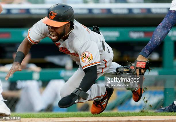 Cedric Mullins of the Baltimore Orioles is tagged out by Jeimer Candelario of the Detroit Tigers while trying to score when caught in a rundown...