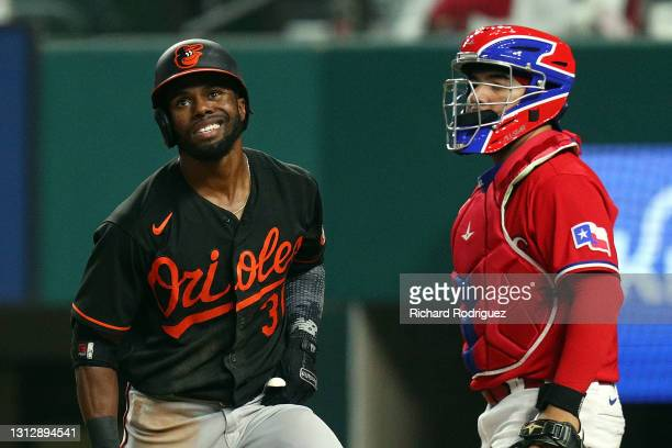 Cedric Mullins of the Baltimore Orioles reacts after striking out in the seventh inning against the Texas Rangers at Globe Life Field on April 16,...