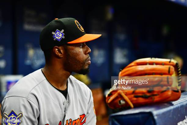 Cedric Mullins of the Baltimore Orioles wears a jersey and hat to honor Jackie Robinson before a game against the Tampa Bay Rays at Tropicana Field...
