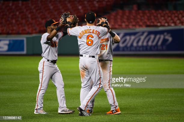 Cedric Mullins, Ryan Mountcastle, and Austin Hays of the Baltimore Orioles all celebrate after beating the Boston Red Sox at Fenway Park on September...