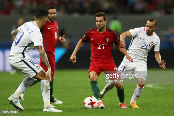 Cedric of Portugal and Marcelo Diaz of Chile battle for possession during the FIFA Confederations Cup Russia 2017 SemiFinal between Portugal and...