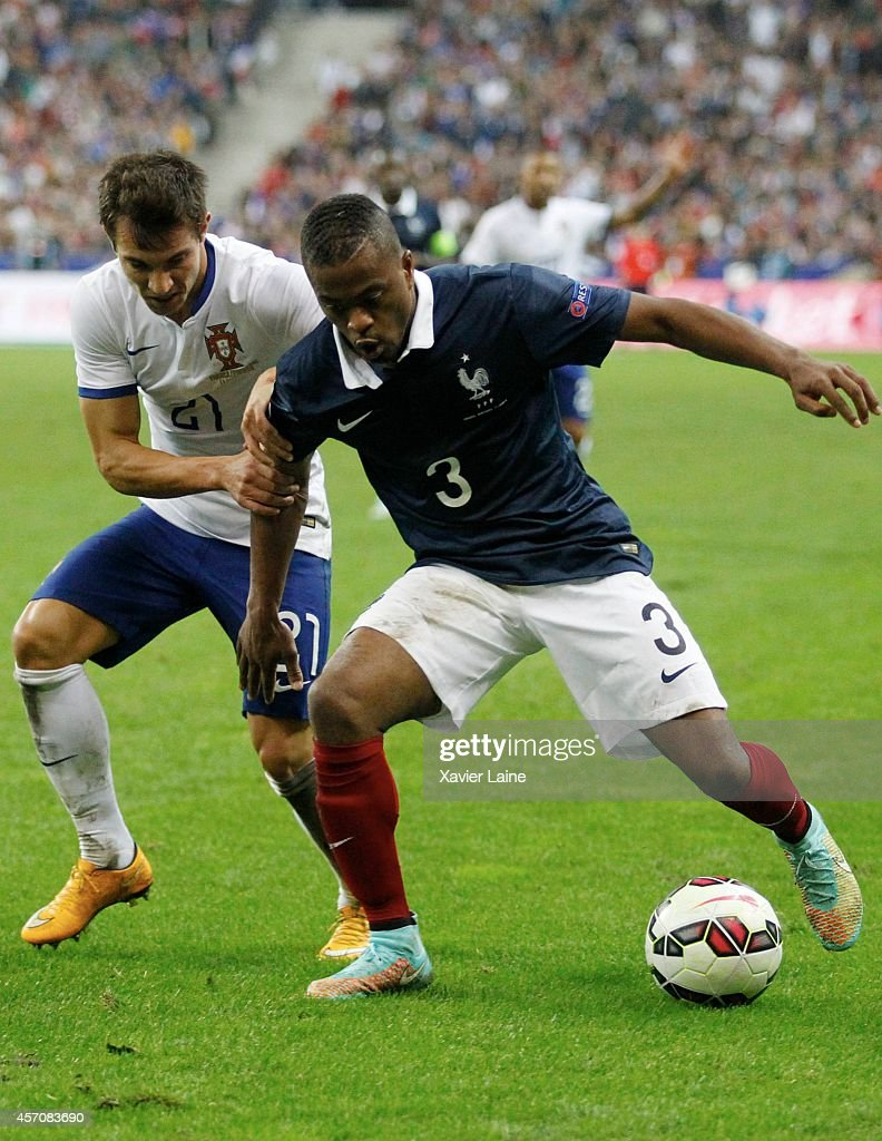 Cedric of Portugal and Patrick Evra of France during the International Friendly Soccer match between France and Portugal at Stade de France on october 11, 2014 in Paris, France.