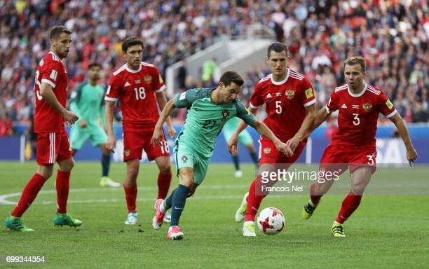 Cedric of Portugal attempts to shoot while he is closed down by the Russia defence during the FIFA Confederations Cup Russia 2017 Group A match...