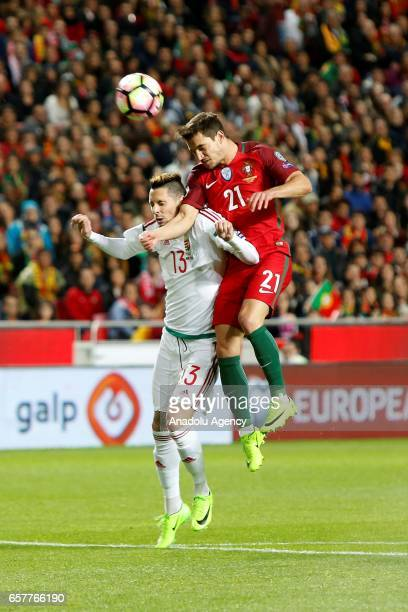 Cedric of Portugal competes for the ball with Adam Gyurcso of Hungary during the 2018 FIFA World Cup Qualifying Group B match between Portugal and...