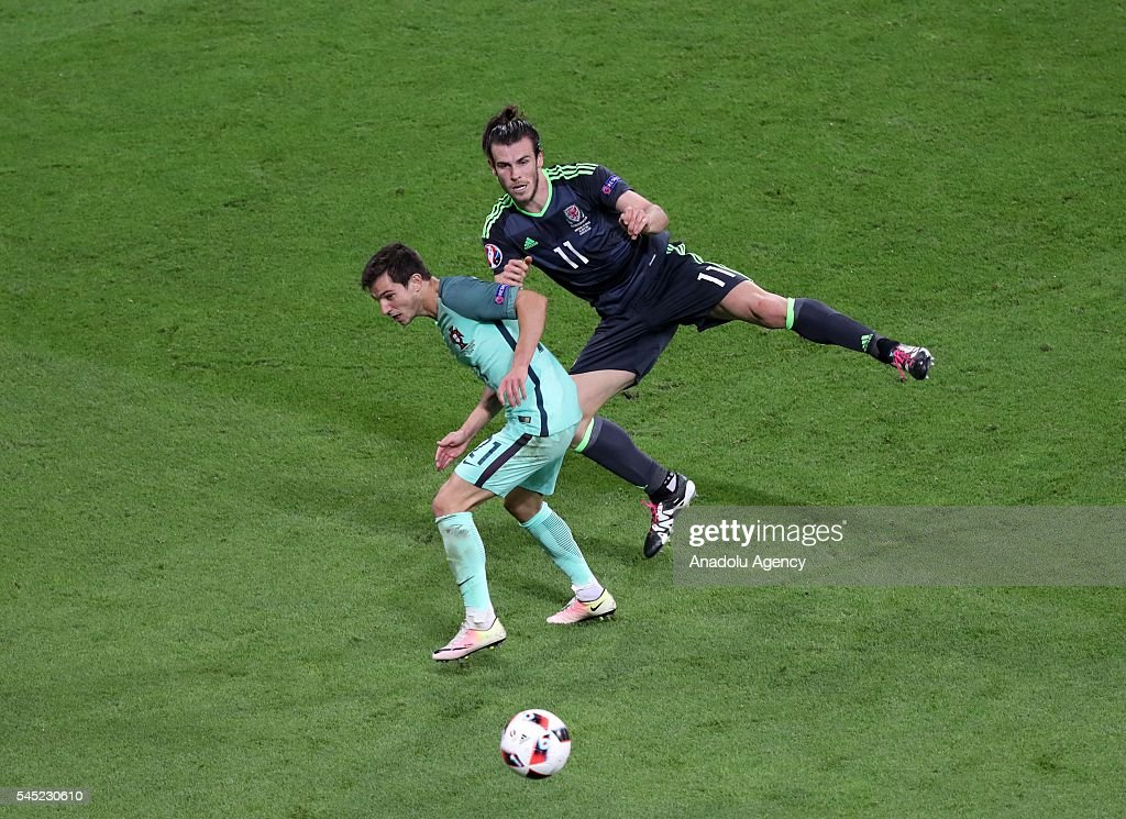 Cedric (21) of Portugal in action against Gareth Bale (11) of Wales during the UEFA Euro 2016 semi final match between Portugal and Wales at Stade de Lyon in Lyon, France on July 6, 2016.