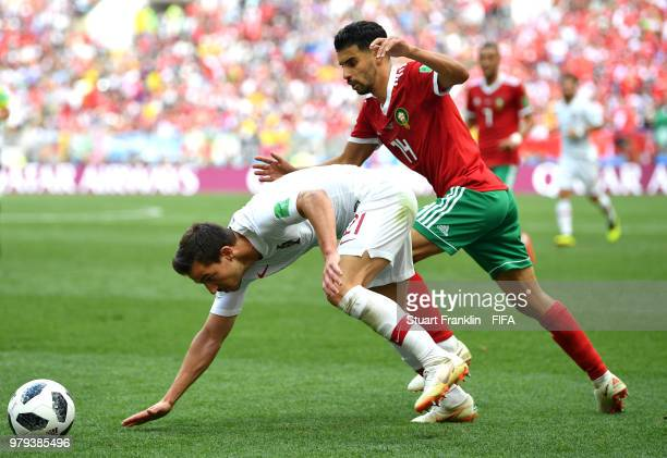 Cedric of Portugal is challenged by Mbark Boussoufa of Morocco during the 2018 FIFA World Cup Russia group B match between Portugal and Morocco at...