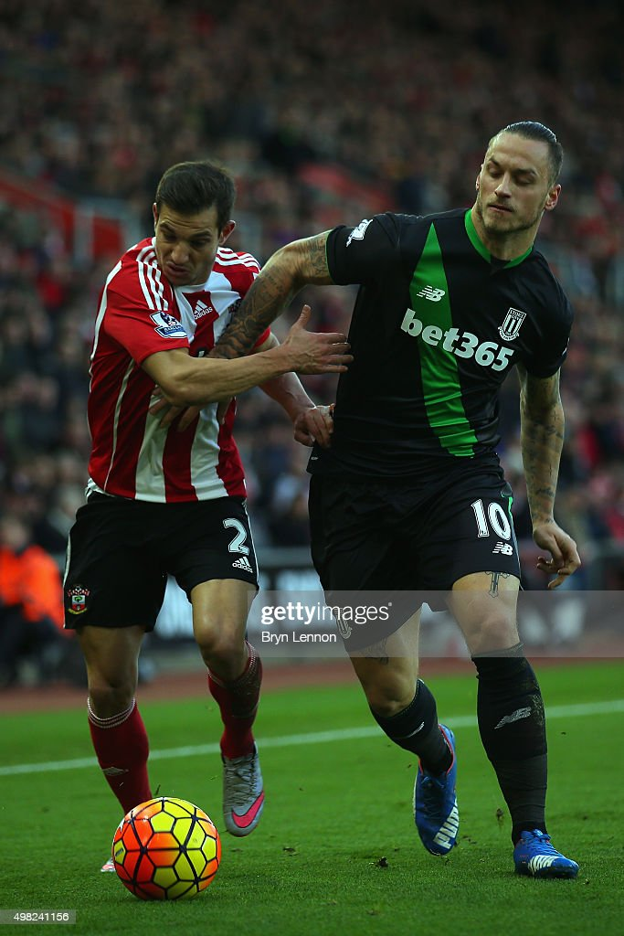 Cedric of Southampton battles with Marko Arnautovic of Stoke City during the Barclays Premier League match between Southampton and Stoke City at St Mary's Stadium on November 21, 2015 in Southampton, England.