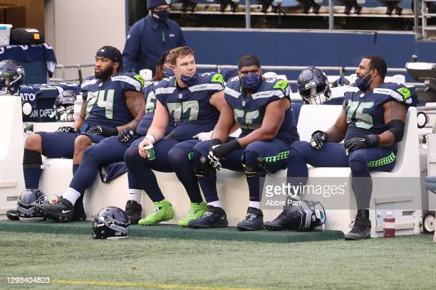 Cedric Ogbuehi, Ethan Pocic, Jordan Simmons and Duane Brown of the Seattle Seahawks react from the sidelines in the second quarter against the Los...