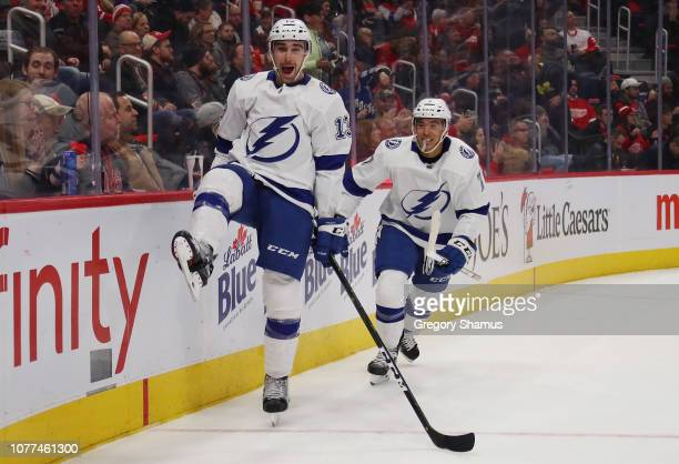 Cedric Paquette of the Tampa Bay Lightning celebrates his third period goal with Mathieu Joseph while playing the Detroit Red Wings at Little Caesars...