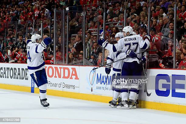 Cedric Paquette of the Tampa Bay Lightning celebrates with his teammates after scoring a goal in the third period against Corey Crawford of the...
