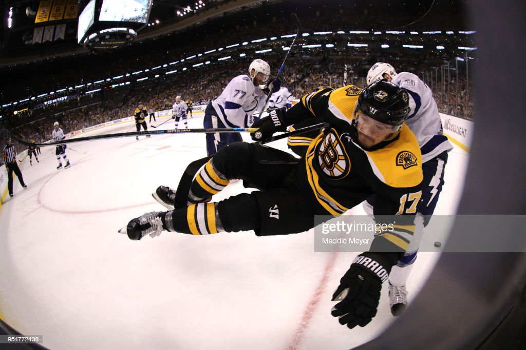 Cedric Paquette #13 of the Tampa Bay Lightning checks Ryan Donato #17 of the Boston Bruins into the boards during the third period of Game Four of the Eastern Conference Second Round during the 2018 NHL Stanley Cup Playoffs at TD Garden on May 4, 2018 in Boston, Massachusetts.