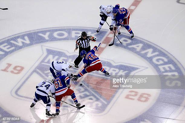 Cedric Paquette of the Tampa Bay Lightning faces off against Derick Brassard of the New York Rangers to start Game Two of the Eastern Conference...