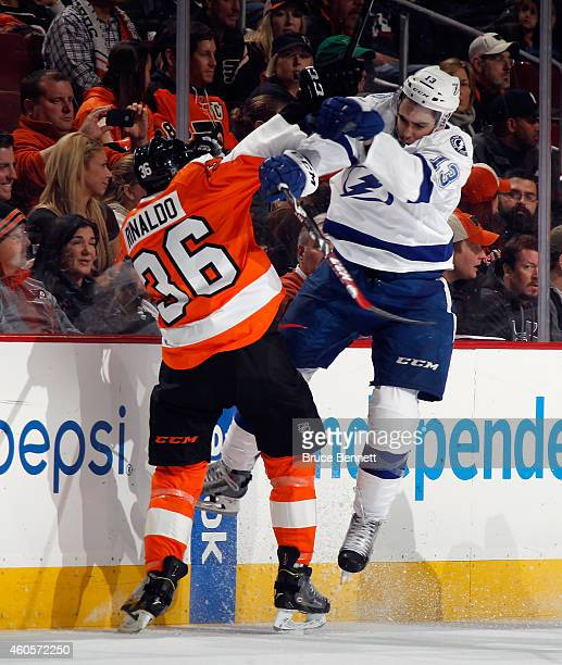 Cedric Paquette of the Tampa Bay Lightning hist Zac Rinaldo of the Philadelphia Flyers during the third period at the Wells Fargo Center on December...
