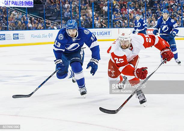Cedric Paquette of the Tampa Bay Lightning races against Mike Green of the Detroit Red Wings during the first period of Game Five of the Eastern...