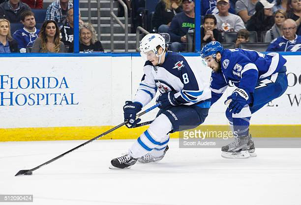 Cedric Paquette of the Tampa Bay Lightning skates against Jacob Trouba of the Winnipeg Jets during the first period at the Amalie Arena on February...