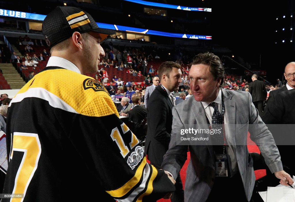 Cedric Pare greets John Ferguson Jr. after being selected 173rd overall by the Boston Bruins during the 2017 NHL Draft at United Center on June 24, 2017 in Chicago, Illinois.