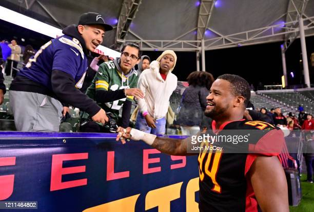 Cedric Reed of the LA Wildcats interacts with fans after playing the Tampa Bay Vipers at Dignity Health Sports Park during an XFL game on March 8...