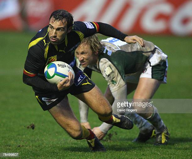 Cedric Rosalen of Perpignan moves away from Peter Richards during the Heineken Cup match between Perpignan and London Irish at Stade Aime Giral on...