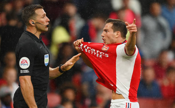 Cedric Soares of Arsenal appeals to Match Referee, Paul Tierney during the Premier League match between Arsenal and Chelsea at Emirates Stadium on...