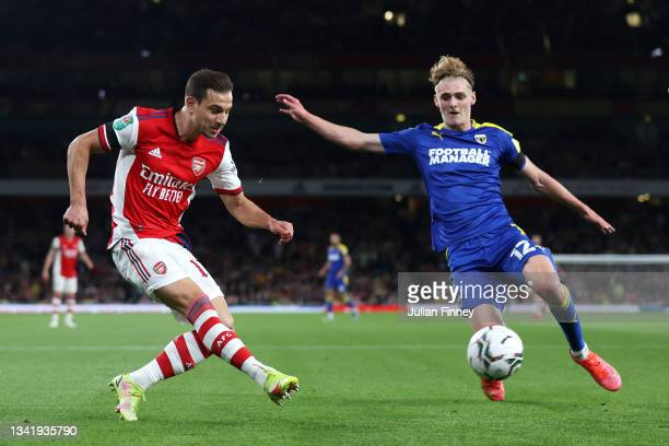 Cedric Soares of Arsenal battles for possession with Jack Rudoni of AFC Wimbledon during the Carabao Cup Third Round match between Arsenal and AFC...