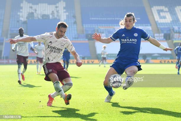 Cedric Soares of Arsenal crosses the ball under pressure from Caglar Soyuncu of Leicester during the Premier League match between Leicester City and...