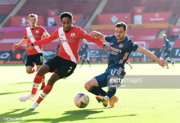 Cedric Soares of Arsenal crosses the ball under pressure from Kyle Walker-Peters of Southampton during the FA Cup 4th round match between Southampton...