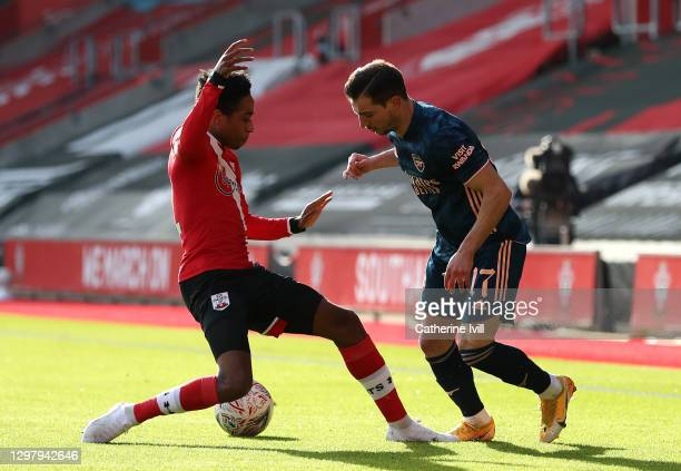 Cedric Soares of Arsenal is challenged by Kyle Walker-Peters of Southampton during The Emirates FA Cup Fourth Round match between Southampton FC and...
