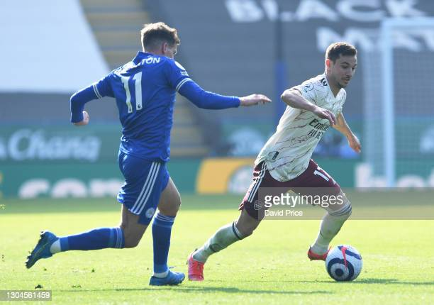 Cedric Soares of Arsenal takes on Marc Albrighton of Leicester during the Premier League match between Leicester City and Arsenal at The King Power...